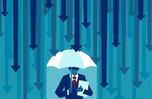 Man under umbrella with arrows as rain
